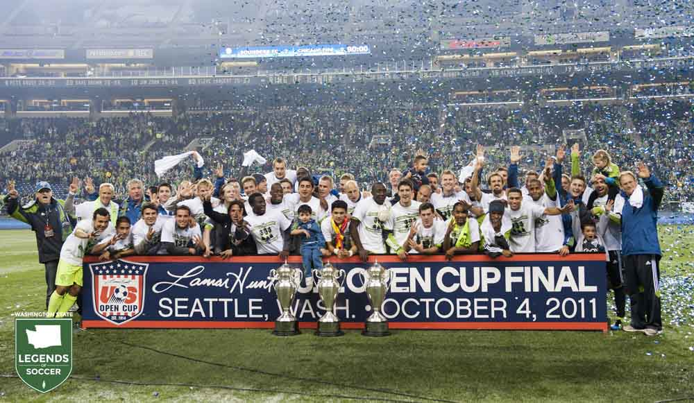 Sounders FC players and staff celebrate becoming the first club in 42 years to win three consecutive U.S. Open Cups after a 2-0 victory over Chicago. (Sounders FC photo)