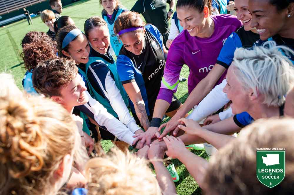Hope Solo, right, and Reign FC are all smiles while tripling their points in their second year and improving the goal difference by 44. (Jane Gersovich photo)