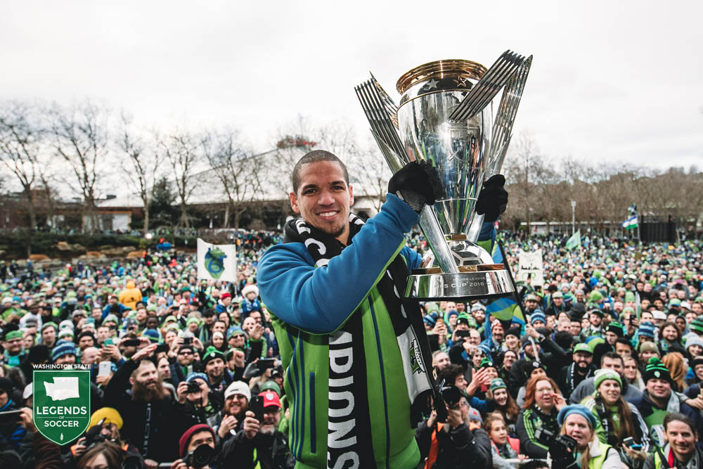 Sounders captain and original team member Osvaldo Alonso presents the MLS Cup to thousands of fans at Seattle Center. (Courtesy Sounders FC)