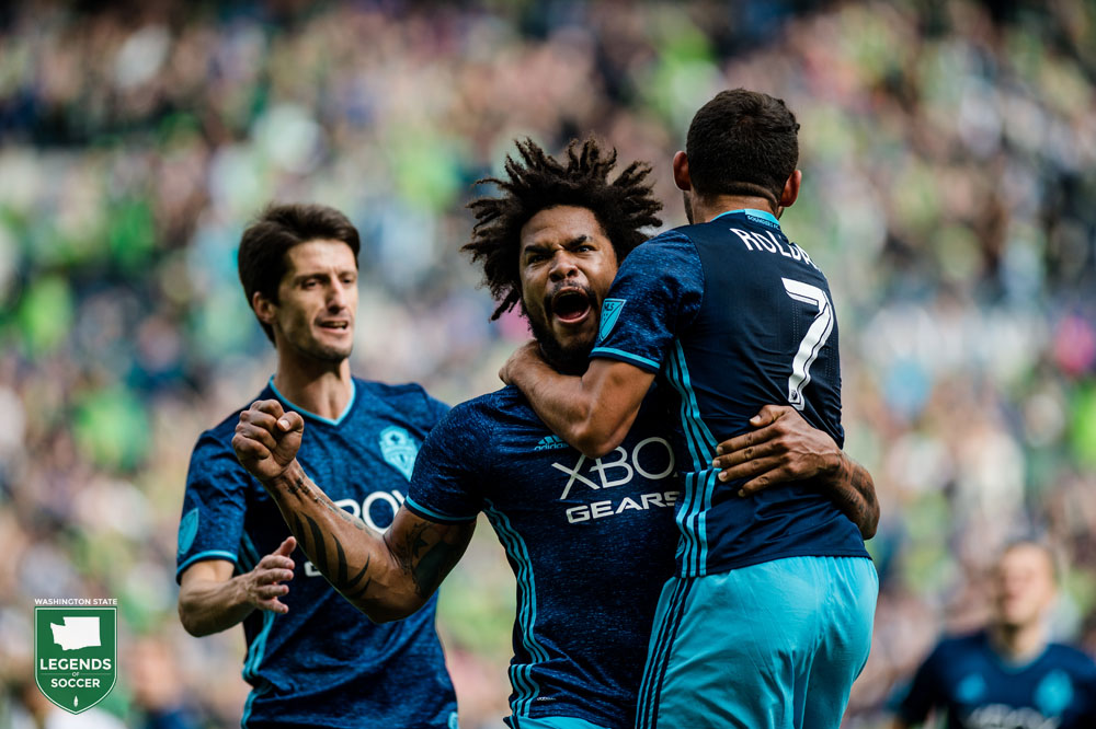 Alvaro Fernandez (l), Roman Torres and Cristian Roldan celebrate the latter's goal, which clinches an MLS Cup playoff spot for the Sounders. (Courtesy Sounders FC)