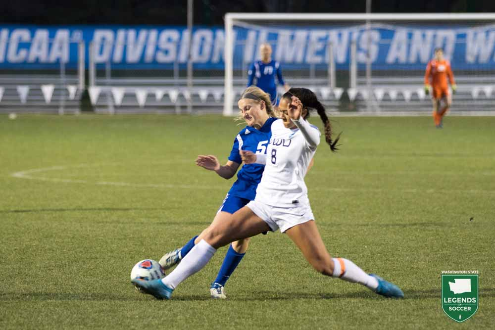 Division II Player of the Year Sierra Shugarts battles for possession in Western Washington's 3-2 championship win over Grand Valley State.