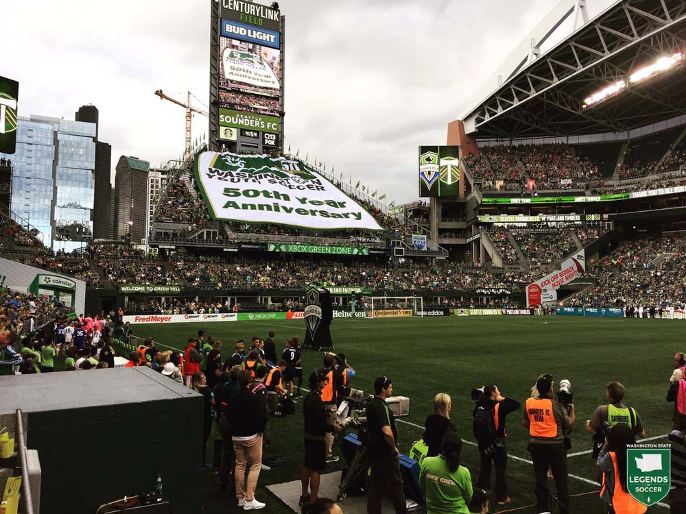 Washington Youth Soccer unveils its 50th anniversary banner at CenturyLink Field prior to the Sounders'  3-1 win over Portland, 8/21/2016.