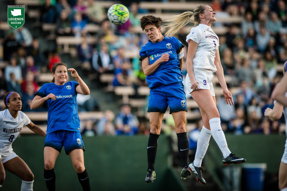 Keelin Winters, Seattle Reign captain, vies for a high ball at Memorial Stadium as Kendall Fletcher looks on. Winters retired after the 2016 season, her fifth in Seattle, including one with Sounders Women. (Courtesy Seattle Reign)
