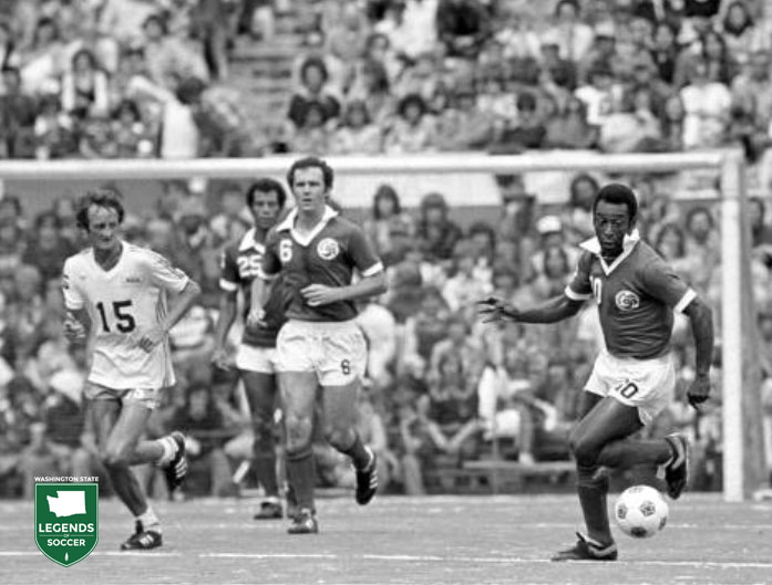 Seattle's Steve Buttle keeps an eye on Pele´, far right, as the Cosmos' Carlos Alberto and Franz Beckenbauer look on.