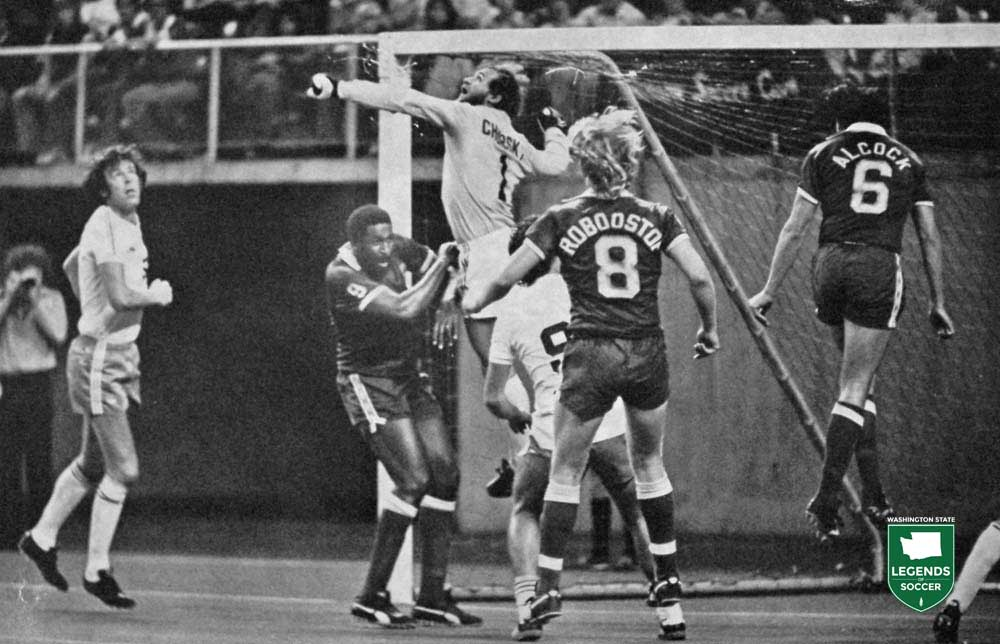 Tony Chursky rises to punch out a Portland cross to Clyde Best.