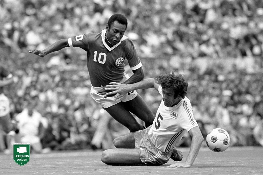 Mike England of the Sounders goes in for the tackle on New York's Pele´.