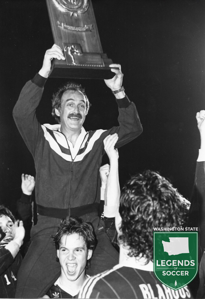 Lifting the NCAA championship trophy in Tampa was none other than Seattle Pacific coach Cliff McCrath.