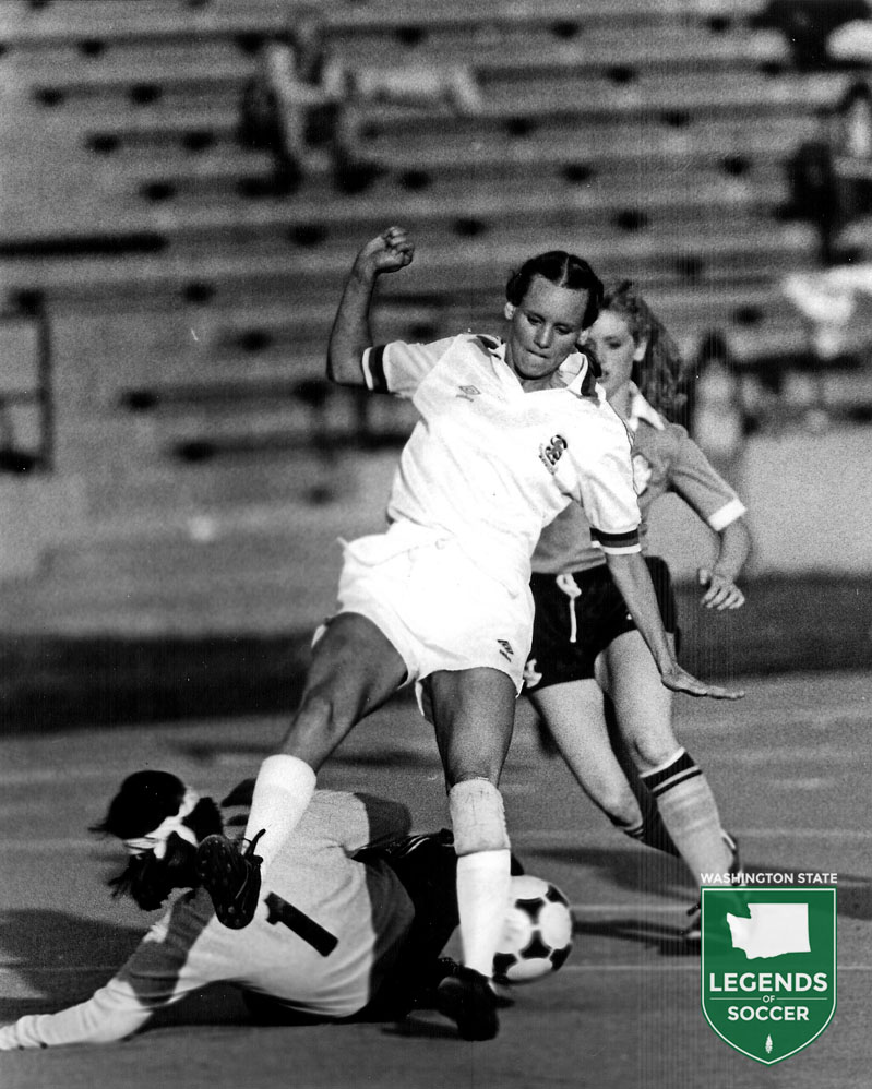 Lowenbrau Zurich forward Joan Dunlap tests the Rochester keeper.